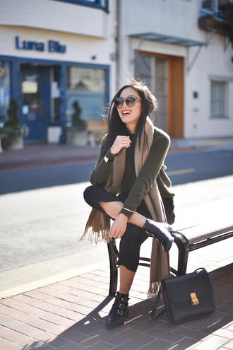 shoes brown scarf dark green shirt sunglasses black pants buckle boots blogger
