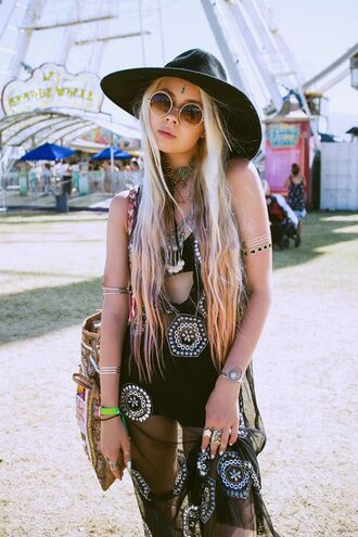 dress coachella outfit black dress see through see through dress mesh mesh dress bikini bikini top statement necklace necklace silver necklace jewels jewelry silver jewelry shorts black shorts bag printed bag felt hat hat black hat boho round sunglasses sunglasses long hair hair blonde hair hairstyles