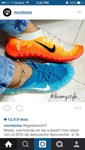 shoes,colorful,tennis shoes,orange,blue,nikes,comfortable running shoes,walk on air,running shoes