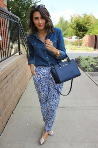 shoes sandals silver flat sandals silver sandals pants printed pants blue pants shirt denim shirt blue shirt bag black bag michael kors bag michael kors flat sandals silver low heel sandals spring outfits