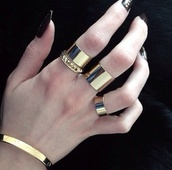 jewels,cartier gold bracelet,cartier ring,cartier,gold,gold ring,knuckle ring,spikes,studs,ring,rings with studs,studded ring,gold midi rings,gold bracelet,bracelets,shorts