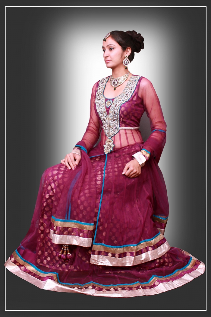 Presenting a stunning embroidered bridal lehenga in net,printed with silk.