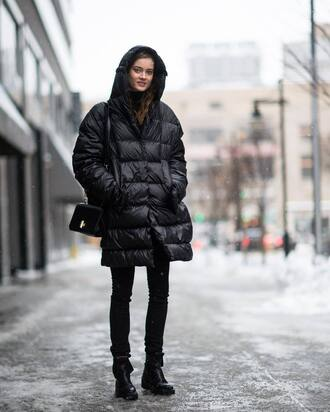 coat tumblr black coat quilted bag black bag nyfw 2017 fashion week 2017 fashion week streetstyle denim jeans black dress skinny jeans boots black boots flat boots winter outfits winter look