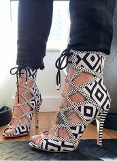 shoes,aztec,aztec print shoes,heels,black,white,black and white,sandals,open toes,high heels,lace-up shoes,gold,pattern,strappy sandals,fashion,tribal pattern,print,black and white shoes,cute