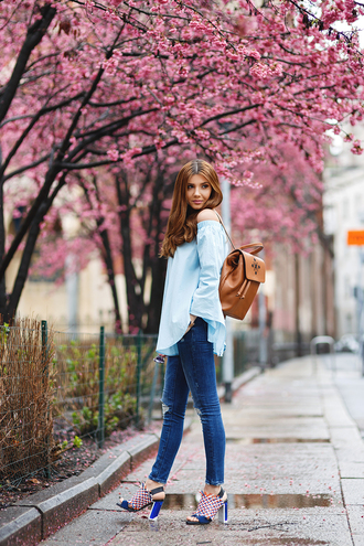 the mysterious girl blogger jewels sunglasses blue top light blue brown bag backpack blue heels