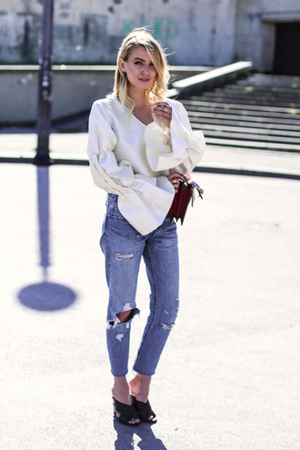 ohh couture blogger sunglasses bag jewels ripped jeans white blouse long sleeves bell sleeves wedges black heels boyfriend jeans