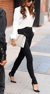 pants,clothes,victoria beckham,black trousers,harem pants,white blouse,black pumps,studded clutch,bag,shirt,outfit,black and white,black,white