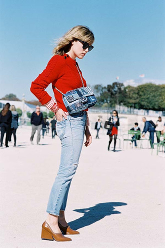vanessa jackman blogger red sweater denim bag thick heel straight jeans red cable knit sweater sweater blue bag crossbody bag jeans light blue jeans sunglasses black sunglasses glove heel block heels
