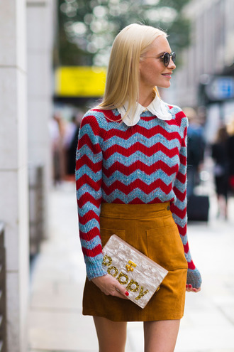 sweater chevron printed sweater long sleeves fall sweater fall outfits fashion week 2016 fashion week london fashion week 2016 mustard mini skirt fall skirt clutch sunglasses poppy delevingne celebrity celebrity style streetstyle