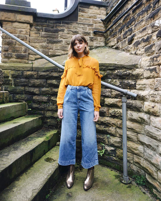 blouse ruffled top top yellow yellow top ruffle denim jeans blue jeans wide-leg pants boots silver boots