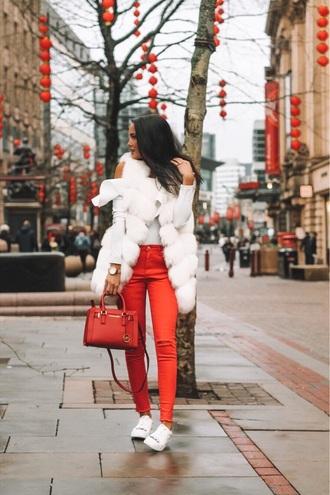 leona meliskova blogger jacket jeans bag shoes fur vest fur jacket winter outfits red bag red pants sneakers