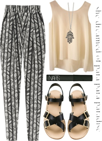pants loose navajo ethnic ethnic print boho bohemian black and white shoes blouse printed pants striped pants jewels hamsa hand hamsa necklace all items shirt hippie hippy pants hippy shirt hippie glasses fringed top peace bracelet jeans