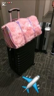 bag,home accessory,pink luggage