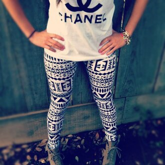 pants aztec leggings clothes t-shirt boots shoes fashion black and white shirt jeans tribal print leggings tights