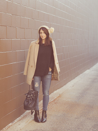 lady a la mode blogger pom pom beanie camel coat ripped jeans leather bag