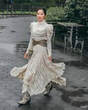 dress,asymmetrical dress,long sleeve dress,puffed sleeves,belt,mini bag,snake print,ankle boots,earrings