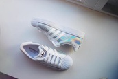 shoes,adidas superstars,adidas,sneakers,holograhic,hologram sneakers,addidas superstar sneakers,glitter shoes,holographic adidas superstars  s,where can i get these for lesss than £70,holographic,adidas shoes,opalescent,white,rainbow,adidas originals,asos,superstar adidas,lexee smith,holographic shoes,nike
