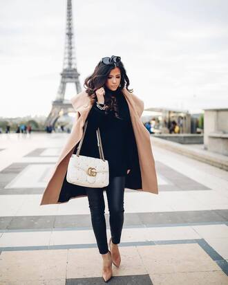 thesweetestthing blogger sweater hat jacket bag shoes winter outfits fall outfits nude coat gucci bag high heel pumps nude heels coat tumblr camel camel coat black sweater white bag gucci pants black pants black leather pants leather pants pumps pointed toe pumps sunglasses black sunglasses