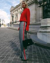 sweater,knitted sweater,red sweater,pants,wide-leg pants,shoulder bag,pumps,high heels,chanel,high waisted pants
