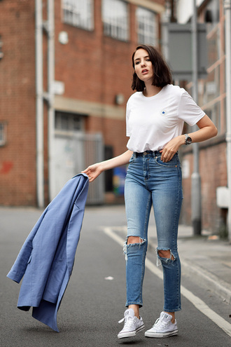 shot from the street blogger casual light blue white t-shirt ripped jeans