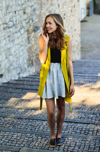 a cup of style blogger grey skirt sleeveless coat yellow loafers