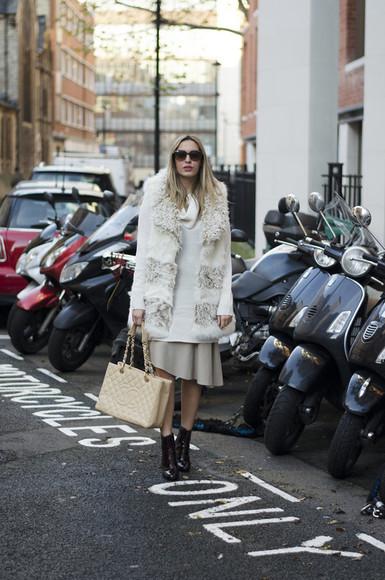 midi skirt blogger bag sunglasses camila carril asymmetrical black boots fluffy