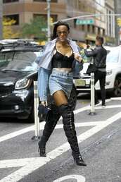 underwear,winnie harlow,model off-duty,boots,over the knee,denim jacket,mini skirt,denim skirt,victoria's secret model