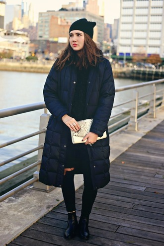 color me nana blogger winter outfits down jacket winter coat ripped jeans pouch puffer jacket beanie black beanie black jacket denim jeans black jeans clutch snake print winter look cold weather outfit