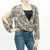 Open sleeve animal print surplice blouse