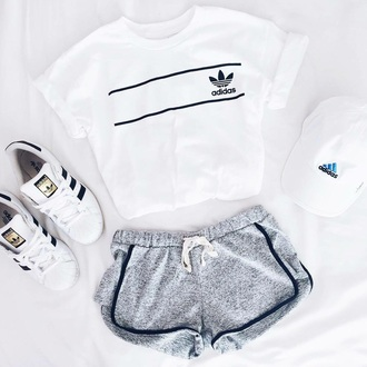 shirt adidas girly white outfit grey shorts adidas superstars cap t-shirt shorts short grey earphones shoes style scrapbook style black black and white cute sporty pants adidas shirt top white t-shirt sportswear adidas tee shirt black and grey logo cotton sports shorts white adidas top cool girl crop tops instagram adidas hat adidas shoes causal shoes adidas originals