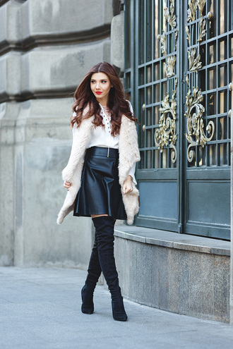 the mysterious girl blogger jacket shirt skirt shoes bag jewels make-up white fur vest lace up top white top black leather skirt leather skirt black skirt mini skirt boots black boots