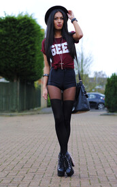 black hat,burgundy top,quote on it,graphic tee,necklace,jewels,jewelry,High waisted shorts,black shorts,knee high socks,black bag,black boots,leather shorts,bag,shirt,gee,shirr,burgundy,style,shorts,tights,black tights