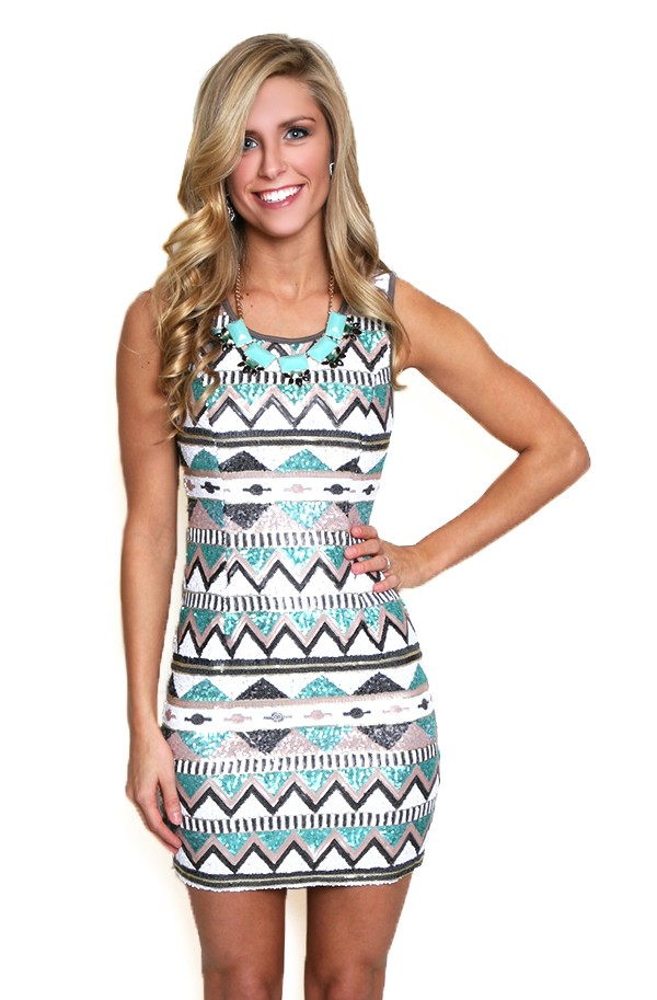 REVERSE Dresses for Women Show off your figure in this bodycon REVERSE dress with tribal-print. Scoop neckline with open back and elastic straps