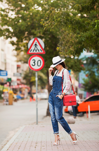 the bow-tie blogger red bag denim overalls white blouse white shoes