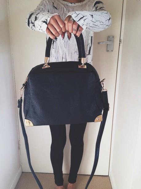 bag black bag black and gold shirt