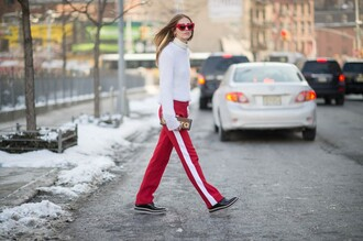 the blonde salad blogger red sunglasses heart sunglasses red pants white sweater clutch