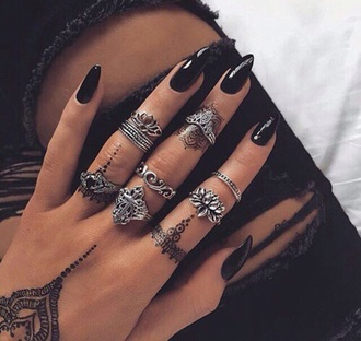 jewels ring knuckle ring rings and tings silver silver ring silver jewelry jewelry ring stack nail accessories nails lotus nail polish acrylic nails acrylics black black ripped jeans ripped jeans jeans black jeans boho jewelry henna black nails