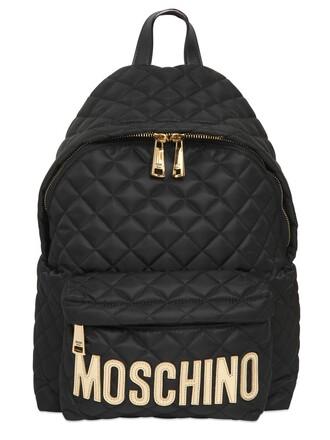 quilted backpack gold black bag
