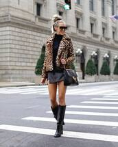 jacket,faux fur jacket,leopard print,black boots,leather boots,knee high boots,leather skirt,mini skirt,wrap skirt,asymmetrical skirt,black turtleneck top,shoulder bag,sunglasses