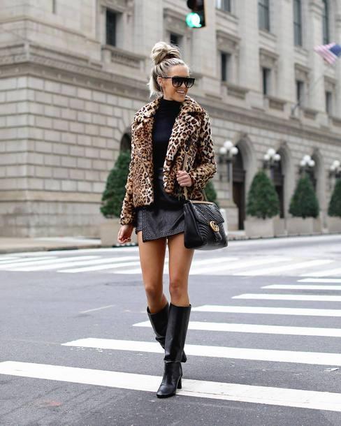 jacket faux fur jacket leopard print black boots leather boots knee high boots leather skirt mini skirt wrap skirt asymmetrical skirt black turtleneck top shoulder bag sunglasses