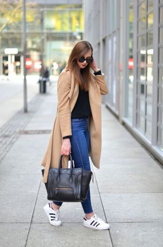 shoes black shirt skinny jeans sunglasses brown coat black bag adidas shoes blogger