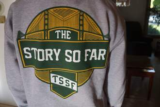 sweater quote on it green gray white yellow