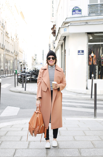 bag fringe backpack backpack brown backpack fringes coat long coat winter outfits winter coat pink coat top striped top pants black pants sneakers white sneakers beanie sunglasses black beanie aviator sunglasses blogger back to school