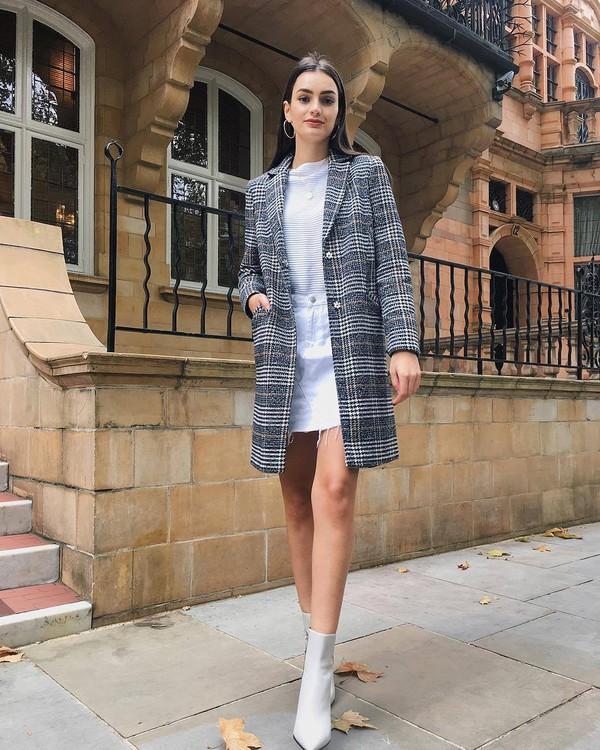 coat checkered sock boots white boots high heels boots mini skirt white jeans white blouse earrings