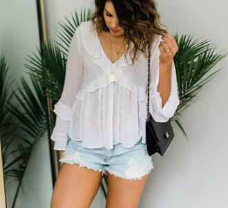top life & messy hair shorts blogger bag jewels chanel bag denim shorts white blouse spring outfits