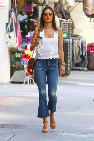 jeans cropped bootcut ripped jeans cropped bootcut jeans cropped bootcut blue jeans cropped jeans blue jeans ripped jeans alessandra ambrosio model off-duty model celebrity style celebrity top white top eyelet top scalloped bag shoulder bag sandals nude sandals sunglasses