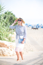 british fashion blog - mediamarmalade,blogger,skirt,blouse,bag,shoes,sunglasses,eyelet skirt,eyelet detail,midi skirt,white skirt,hat,straw hat,black sunglasses,tie-front top,striped top,media marmalade,bell sleeves,clutch,blue clutch,sandals,flat sandals,lace up sandals