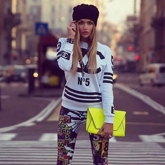 sweater black and white sweatshirt chanel black letters sporty shirt blonde hair n5 crazy pattern stripes neon yellow bag urban bag