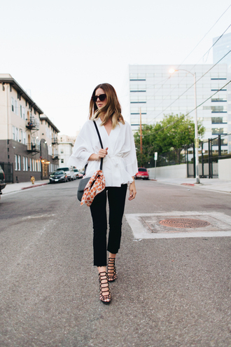 take aim blogger top jeans shoes bag sunglasses le fashion image blouse black jeans cropped jeans cropped bootcut jeans cropped bootcut black jeans wrap dress wrap top black bag long sleeves sandals strappy sandals fall outfits sandal heels high heel sandals black sandals kimono