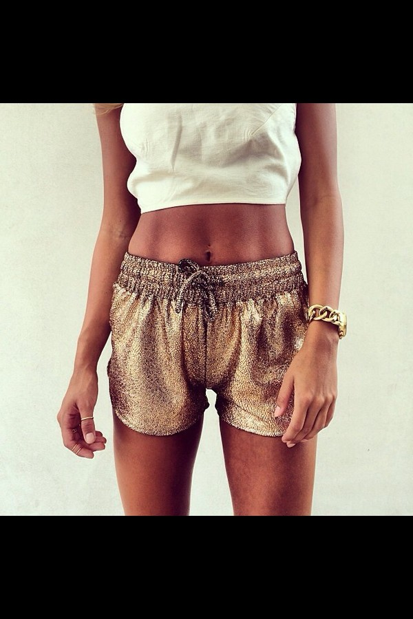 shorts gold party summer pretty tank top t-shirt metallic shorts short summer gold bronze fashion girl celebrity style tan skinny toned sun beach metallic elastic waist glitter